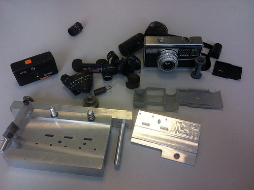 A machine made at IUT Le Mans to slice and perforate/punch 120 film to make 126/110 film- 126 replica cartridge
