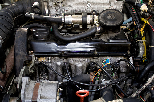 Some what cleaner engine bay after oil leaked each where